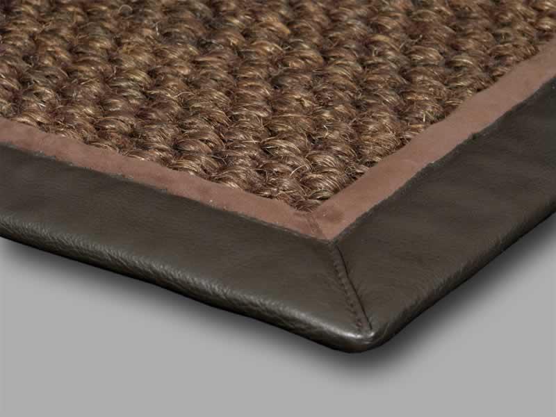 Cunera gulvteppe kantet med skinn.